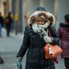 Woman in a coat outside in the winter during a cold day